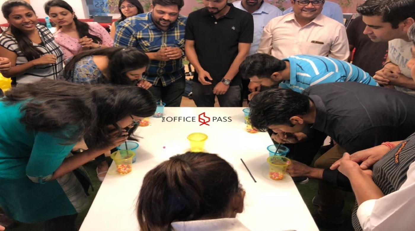 Minute to win it being played at The Office Pass, Coworking space, Gurgaon